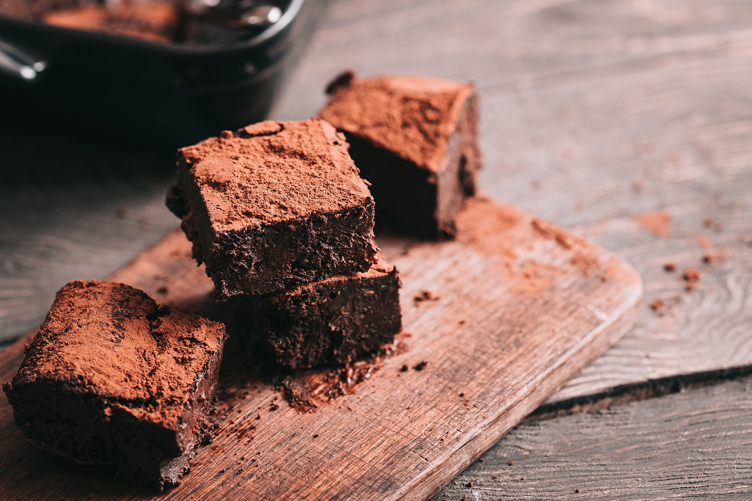 Decadent moist dark chocolate stout beer brownies cut in squares. Dark food photography concept